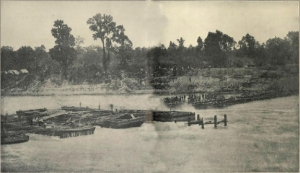 "Known as ""Bailey's Dam"" for the Union officer who ordered its construction, Lt. Col. Joseph Bailey, this timber dam built by the Union Army on the Red River in Alexandria, Louisiana in May 1864 was designed to facilitate passage of Union gunboats to and from the Mississippi River. Photo: Public domain."
