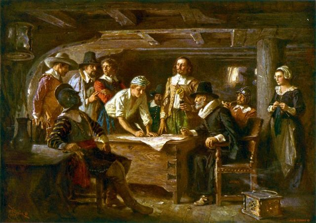 """Passengers of the Mayflower (Carver, Winston, Alden, Myles Standish, Howland, Bradford, Allerton, and Edward Fuller) were depicted signing the """"Mayflower Compact"""" in 1620 in this 1899 painting by J. L. G. Ferris. Edward Fuller was an ancestor of several members of the 47th Pennsylvania Volunteers (image: public domain)."""